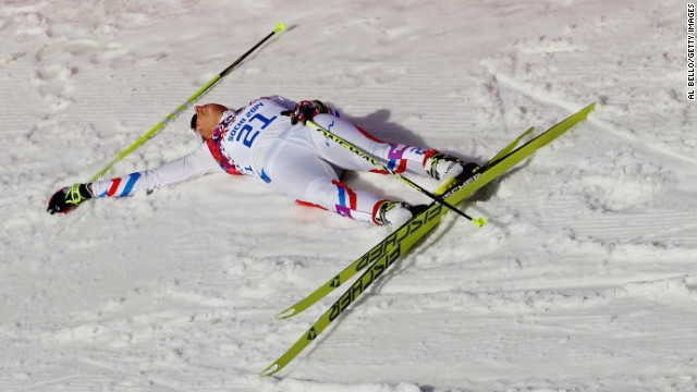 Coraline Hugue of France is exhausted on Saturday, February 22, after finishing seventh in the women's 30-kilometer mass start free cross-country event.