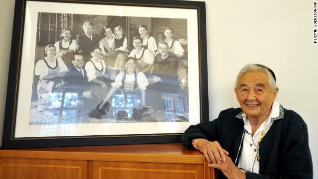 "Maria von Trapp, seen here posing with a photo of her family, was the last of the singing siblings immortalized in the movie ""The Sound of Music."" She died February 18 of natural causes at her Vermont home, according to her family. She was 99."
