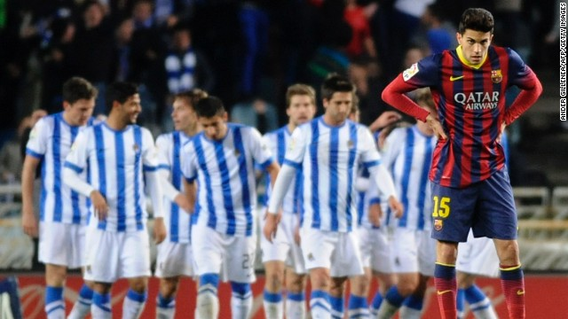 Barcelona defender Marc Bartra, right, can only look away after Real Sociedad scored Saturday.