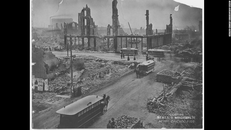 """It's hard to believe Chicago started out as a small trading post at the mouth of the Chicago River. It incorporated as a city on March 4, 1837, and grew exponentially in the decades that followed. Most of its buildings were made of wood. During the dry summer of 1871, a massive fire broke out, destroying more than 17,000 buildings across Chicago and killing 300 people. The cause of the fire was never determined. This photo shows the fire's devastation at the corner of State Street and Madison Street.<!-- --> </br><!-- --> </br><strong><i>Editor's note:</i></strong><i> An earlier version of this gallery had an image of downtown Chicago that was removed because its authenticity was in question. After further review with the source, CNN found the image was misrepresented as an historical photograph. It was in fact a still from the 1937 movie """"In Old Chicago."""" CNN regrets the error.</i>"""