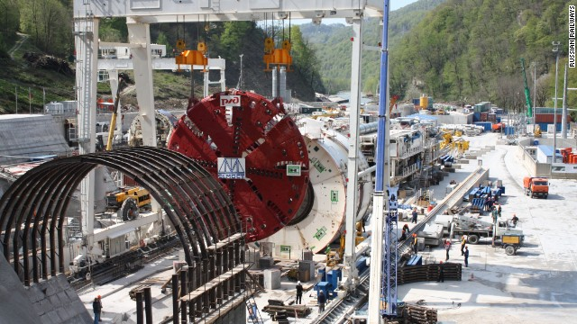 "Six huge boring machines (like the one pictured) and 14 ""harvesters"", which transport the rubble and soil away from the mountain face, along with various drilling and blasting methods were used to drive 30 kilometers of tunnel through the mountains."