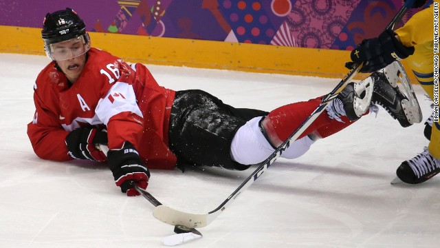 Canada forward Jonathan Toews fights for the puck in the second period of the gold medal men's hockey game against Sweden on Sunday, February 23. As world-class athletes compete in the Winter Olympics, we expect to see elegant and thrilling performances. But some finishes, in triumph, defeat or just plain exhaustion, often involve landing hard on a cold, wet surface. Here, we take a lighter look at those giving their all for a chance at the gold. | More photos: Visions of Sochi
