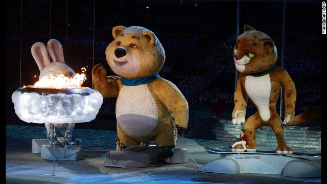 The Bear mascot blows out the Olympic flame.