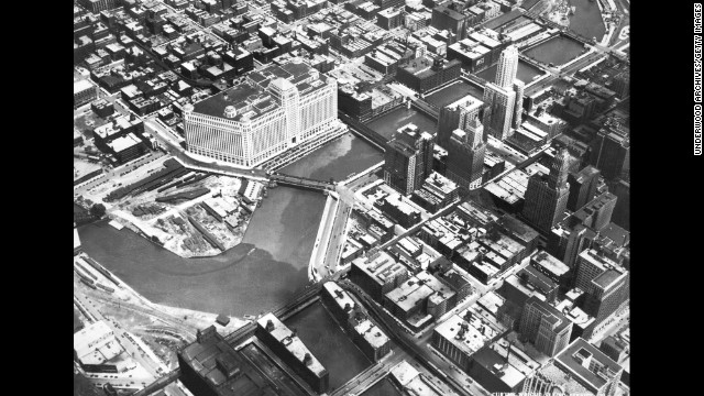 An aerial view of Chicago, circa 1930. The large white building on the Chicago River is the Merchandise Mart, with 4 million square feet of floor space spanning two city blocks and rising 25 stories. It was the largest commercial building in the world when it opened in 1930.