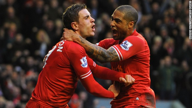 Jordan Henderson, left, celebrates with Glen Johnson after scoring Liverpool's winner against Swansea.