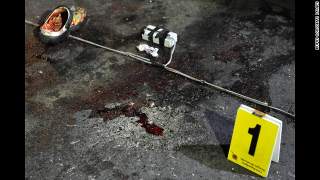Debris is marked at the scene of the explosion in Bangkok on February 23.