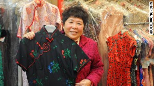 Joana Fung, of Hong Kong\'s Linva Tailor, shows off a prized cheongsam.