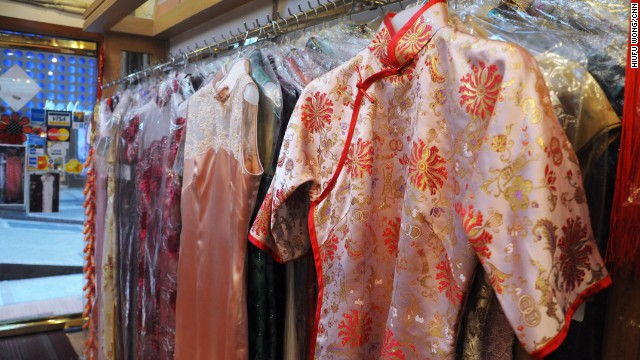 At Hong Kong cheongsam shops, customers choose a style off the rack before deciding on details such as flower buttons on the placket, sleeve length and slit depth.