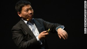 Huawei CEO Richard Yu shows off his TalkBand smart watch ahead of the Mobile World Congress in Barcelona