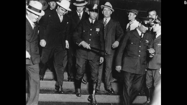 Al Capone -- on the left, wearing the all-white hat -- leaves a Chicago courtroom in the custody of U.S. marshals in October 1931. Capone ran gambling, prostitution and bootlegging operations across Chicago until he was indicted in 1931 for tax evasion. He was convicted and spent the next 11 years in prison.