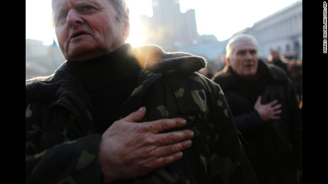 People sing the Ukrainian national anthem at Kiev's Independence Square on Monday, February 24.