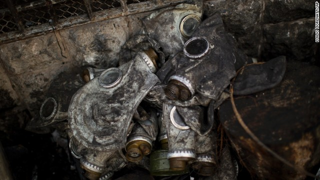 Gas masks used by protesters sit next to a barricade in Independence Square on February 24.