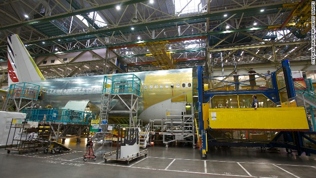 The aircrafts' bodies are joined and their wings are attached. Boeing's 777 holds the nonstop long distance flight record of any commercial jetliner: 11,664 nautical miles (13,422 actual miles).