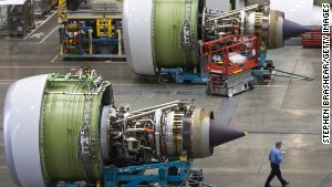 A GE90-115B jet engine dwarfs a Boeing worker. Guinness calls it the most powerful commercially produced jet engine in the world.
