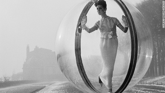 "Photographer Melvin Sokolsky captured the now legendary ""Bubble"" series in 1963 in Paris, for Harper's Bazaar. The only photo retouching involved was to remove traces of an 1/8th inch cable which held the sphere."