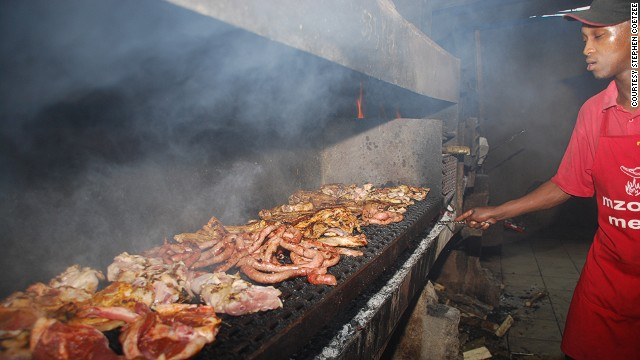 Meat on the braai at Mzoli's in Cape Town.
