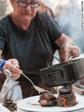 """Elaine Ensor-Smith, part of the winning team on the first season of """"The Ultimate Braai Master,"""" plates up a dish for the judges."""