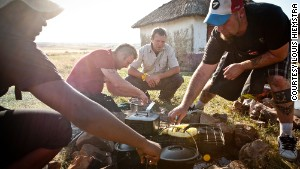 Braaing on an open fire in a rural area of South Africa.