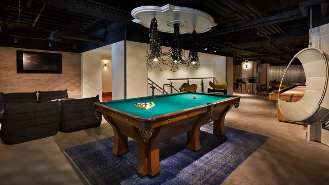 At San Francisco's new Hotel Zetta, the playroom includes a combination of old-school and new games, from shuffleboard and billiards to Wii and a life-size Jenga.