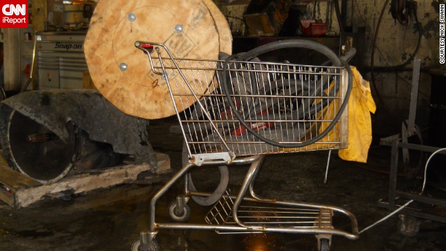 A mechanic attached a <a href='http://ireport.cnn.com/docs/DOC-1093315'>steam jenny hose</a> to a shopping cart that was kept in an old trucking terminal in Rochester, New York.