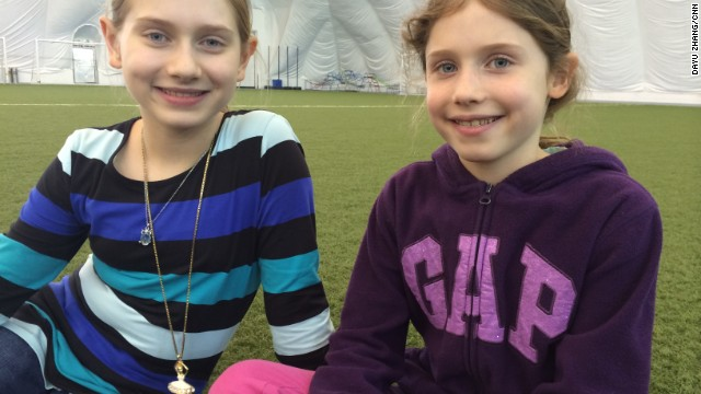 "Students Hanna and Emily Merritt: ""We have the dome but it would be great if we can go outside and play."""