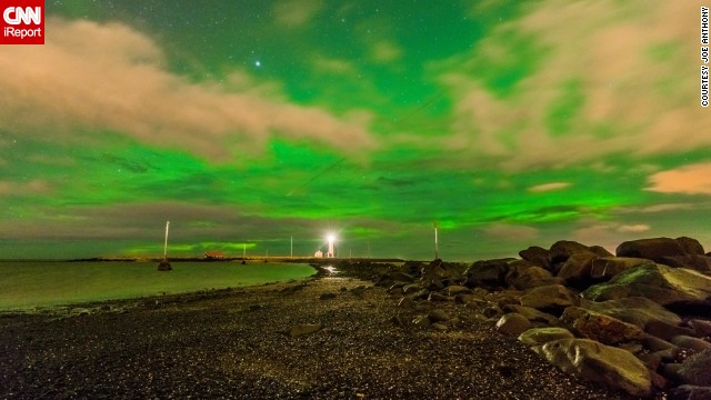 Follow this meteor trail through a glowing sky over a lighthouse in Reykjavik, Iceland. See more photos on <a href='http://ireport.cnn.com/docs/DOC-1075676'>CNN iReport</a>.