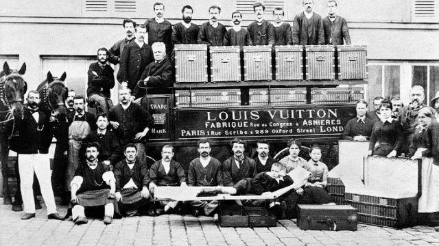 Since its founding in Paris in 1854, the Louis Vuitton company catered to the more glamorous-minded members of society, including empresses, explorers and artists. In this photo from 1888, Louis Vuitton's son Georges and grandson Gaston-Louis pose with factory workers in front of a horse-drawn delivery van.