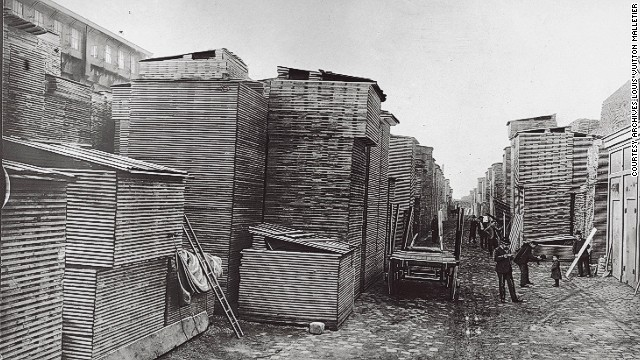 The town of Asnières was chosen as the location of Louis Vuitton's workshop because of its convenient transport links - it sits along the Seine, and is connected to Paris by rail. Here, a 1903 photo shows poplar boards used for manufacturing of trunks unloaded from a barge.