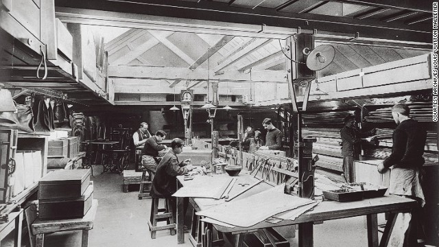 Artisans work in a room bathed in natural light in this image from 1902. This is where fine touches that distinguished Vuitton products were made.