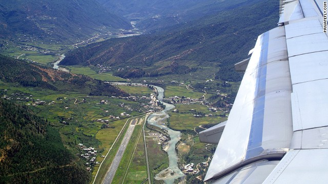 The plunge into this steep valley containing secluded Bhutan's only international airport is as beautiful as it is challenging -- only eight pilots in the world are qualified to land here.