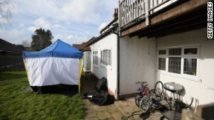 A police forensic tent sits in the garden of Moazzam Begg\'s house in Birmingham, England.