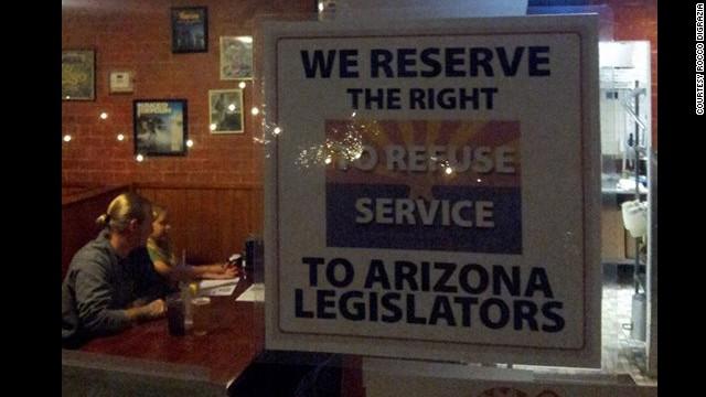 Rocco DiGrazia put this sign up in his Tucson, Arizona, pizzeria after state legislators passed anti-gay legislation.