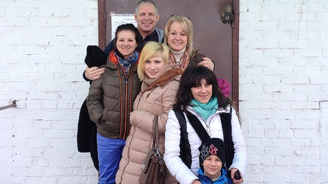"American couple stuck in Ukraine after adopting four orphans: ""I could see the glow of fire"""