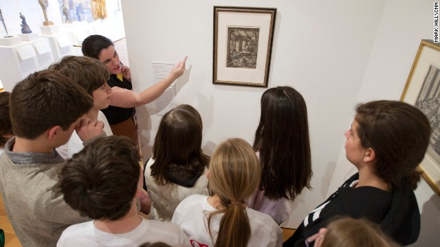 "Christina Westpheling, the teen programs assistant at the High Museum of Art, speaks to a group of sixth grade students about the <a href='https://www.high.org/Art/Exhibitions/Paper-and-Ink.aspx' target='_blank'>""Paper and Ink""</a> exhibit, which allowed students to look inside the practice of printmaking."