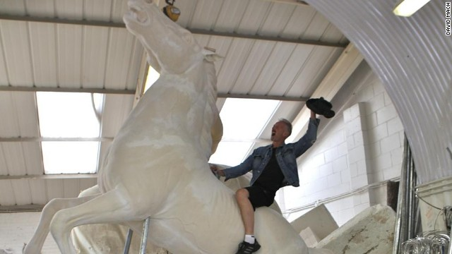 However, his equine experience is limited to a 15-foot horse statue he created and which is for sale. Here he is on board the statuesque steed.