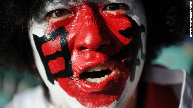 "Fervor for rugby in Japan at all levels is on the rise -- here a fan supports the ""Cherry Blossoms"" during a 2011 Rugby World Cup match in New Zealand."