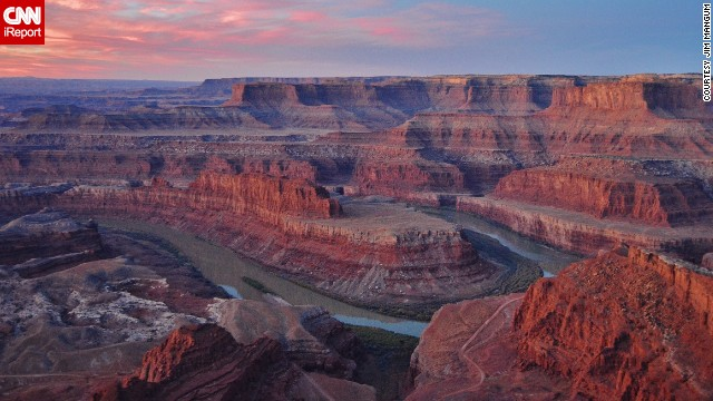 The sun slowly climbs above Dead Horse Point State Park to illuminate the lively colors of the canyon.