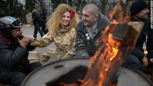 FEBRUARY 26 - KIEV, UKRAINE: Anti-Yanukovych demonstrators sit by a brazier outside the Ukrainian parliament in Kiev. The<a href='http://edition.cnn.com/2014/02/26/world/europe/ukraine-politics/index.html?hpt=hp_t1'> country's interim leaders are due to form a unity government</a>, as UK and U.S. foreign ministers and the IMF meet to discuss emergency financial assistance for the country.