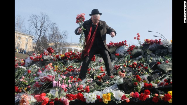 A man places flowers at a barricade near Kiev's Independence Square on February 26.