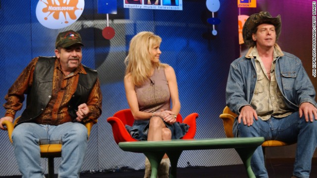 "Nugent, right, talks about his VH1 show ""Surviving Nugent"" in 2004. At right is his wife, Shemane."
