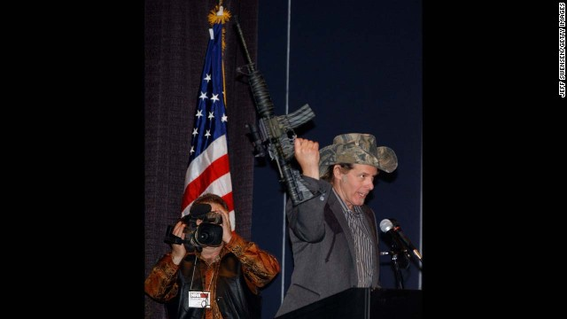 Nugent, a member of the National Rifle Association board of directors, holds up an assault rifle while delivering a speech at the annual NRA Convention in 2004.