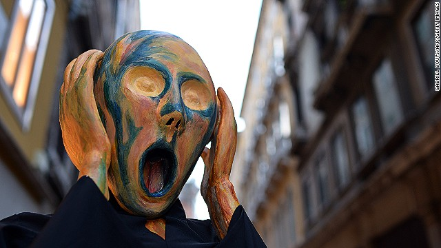 "Masks like the <i>volto</i> can be a source of anxiety, an idea which this reveler plays on with his Munch-inspired costume. Popular culture teaches us to fear people with masks. Just think of Hannibal in ""Silence of the Lambs"" and Jason in ""Friday the 13th""."