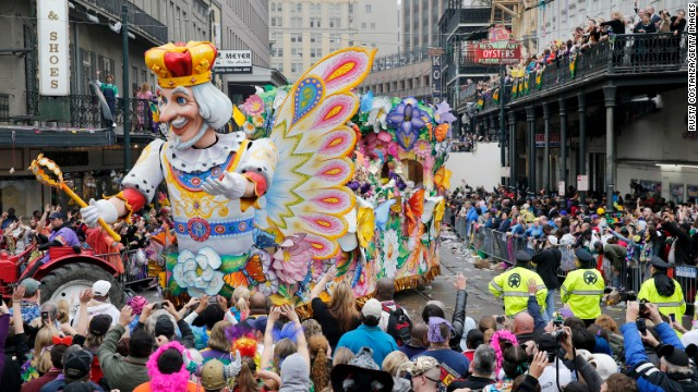 To see the city at its most magnificent, visit during Mardi Gras with people who can help navigate this enormous party. Here's a float in the Rex parade as it turns onto Canal Street.