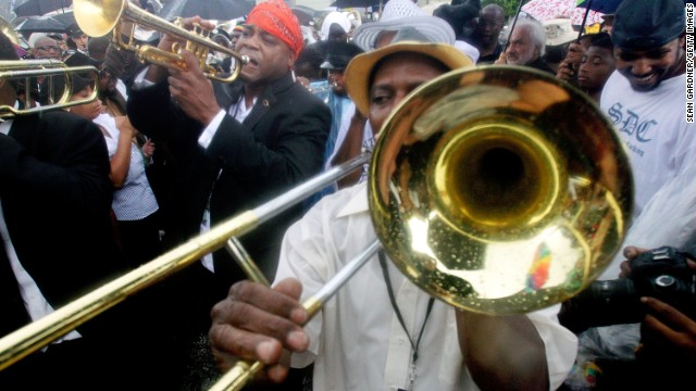 "Music and culture thrive in the neighborhood. Here local musicians play at a jazz funeral in 2012 for bass drumming legend ""Uncle"" Lionel Batiste, who lived in Treme."