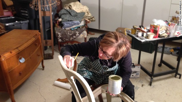 Jan Agnello at work on an antique chair.