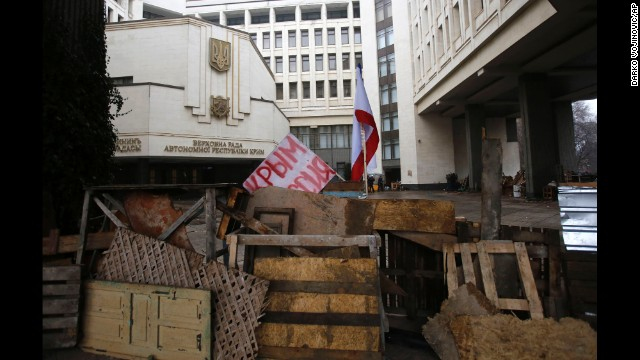 "Barricades in front of a government building in Simferopol on February 27 hold a banner that reads: ""Crimea Russia."" There&squot;s a broad divide between those who support the pro-Western developments in Kiev and those who back Russia&squot;s continued influence in Crimea and across Ukraine."
