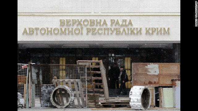Protesters stand in front of a government building in Simferopol on February 27. Tensions have simmered in the Crimea region since the Ukrainian president's ouster.