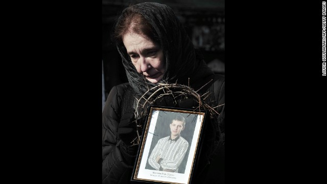 A woman holds a photograph of a protester killed during the height of tensions on February 26 in Kiev.