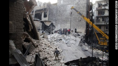 People dig through the rubble of a building hit by alleged Syrian government airstrikes in Damascus on Thursday, February 27.