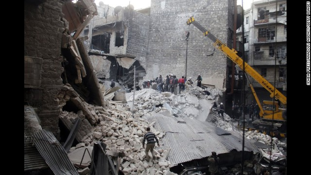 People dig through the rubble of a building in Damascus, Syria, that was allegedly hit by government airstrikes on Thursday, February 27.